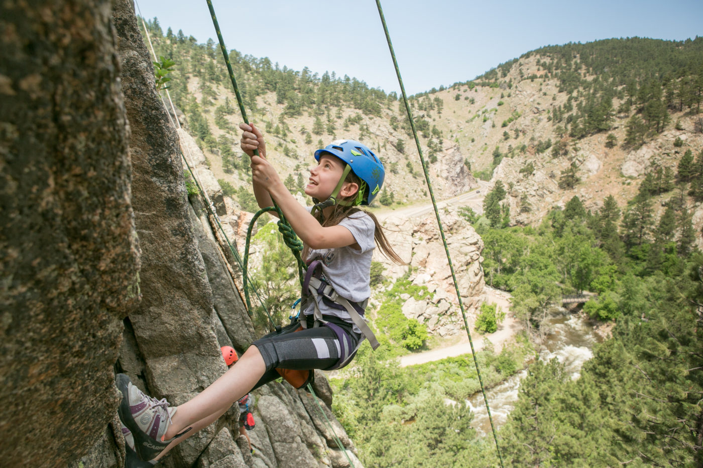 Kids rock climbing at summer camp