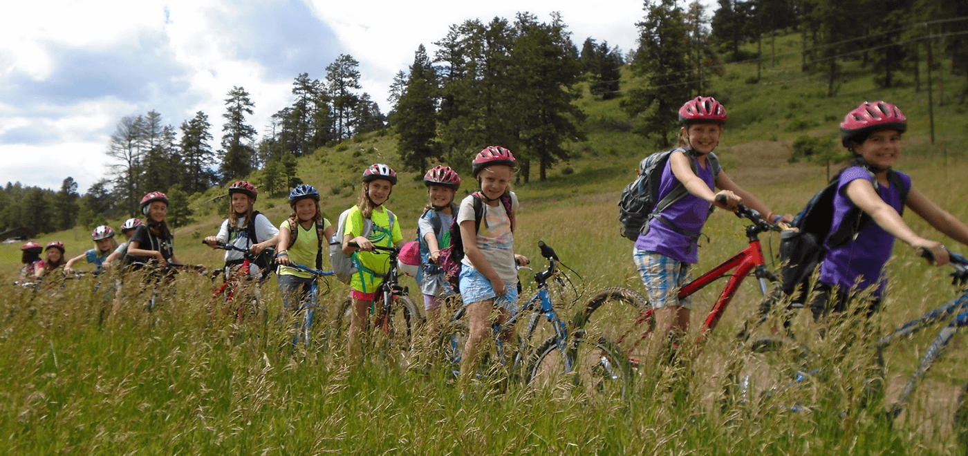 girls biking at summer camp