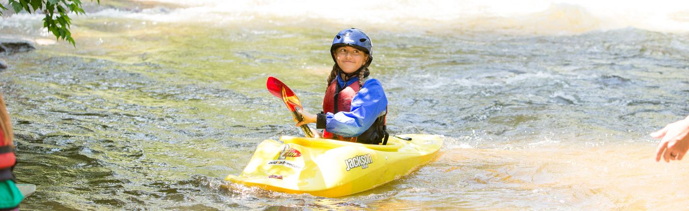 Kids kayaking at summer camp