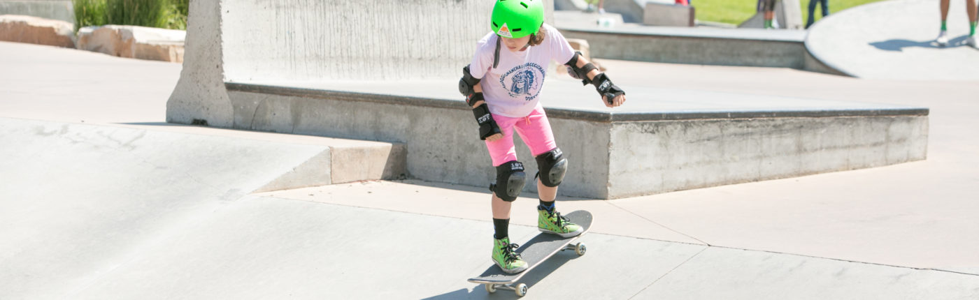 Girl skateboarding at summer camp