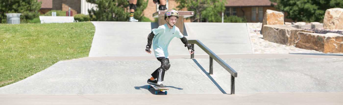 Kid skateboarding at camp