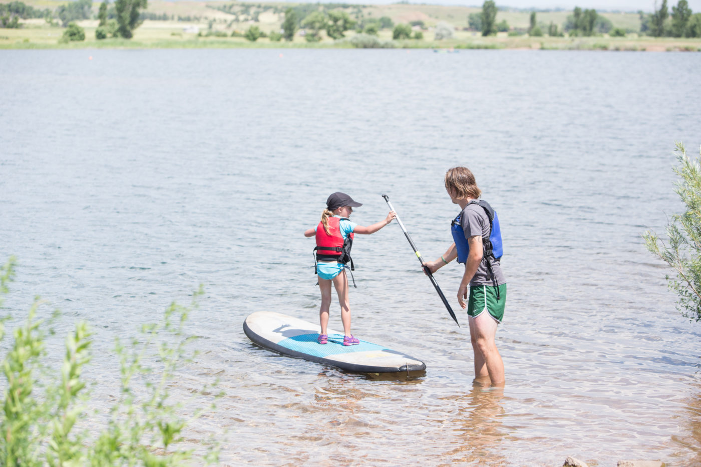 Young child stand up paddleboarding